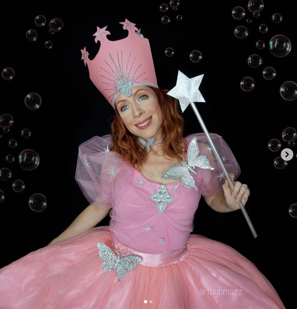 """<p>Don't have a bad bone in your body? Go as Glinda, the good witch. If you want to go the DIY route, the easiest option is to pair a full pink skirt with a pink tank. Then, pin on some matching tulle and silver embellishments. Make the crown with construction paper and a silver paint pen. The wand is simple, too: Cut a star from silver cardstock, then glue it onto a wooden dowel painted silver. </p><p><a class=""""link rapid-noclick-resp"""" href=""""https://www.amazon.com/Womens-Skirt-Line-Vintage-KK659-1/dp/B073NZK4G1?tag=syn-yahoo-20&ascsubtag=%5Bartid%7C10072.g.33534666%5Bsrc%7Cyahoo-us"""" rel=""""nofollow noopener"""" target=""""_blank"""" data-ylk=""""slk:SHOP PINK SKIRT"""">SHOP PINK SKIRT</a></p><p><a class=""""link rapid-noclick-resp"""" href=""""https://www.amazon.com/Jersey-Tank-Hot-Pink-Large/dp/B008KE51YI?tag=syn-yahoo-20&ascsubtag=%5Bartid%7C10072.g.33534666%5Bsrc%7Cyahoo-us"""" rel=""""nofollow noopener"""" target=""""_blank"""" data-ylk=""""slk:SHOP PINK TANK"""">SHOP PINK TANK</a></p><p><a class=""""link rapid-noclick-resp"""" href=""""https://www.amazon.com/Offray-Tulle-Ribbon-6-Inch-25-Yard/dp/B0018N6A1G/?tag=syn-yahoo-20&ascsubtag=%5Bartid%7C10072.g.33534666%5Bsrc%7Cyahoo-us"""" rel=""""nofollow noopener"""" target=""""_blank"""" data-ylk=""""slk:SHOP TULLE"""">SHOP TULLE</a></p><p><a class=""""link rapid-noclick-resp"""" href=""""https://www.amazon.com/Springhill-Colored-Cardstock-147gsm-Sheets/dp/B00O46MJMI/?tag=syn-yahoo-20&ascsubtag=%5Bartid%7C10072.g.33534666%5Bsrc%7Cyahoo-us"""" rel=""""nofollow noopener"""" target=""""_blank"""" data-ylk=""""slk:SHOP PINK CARDSTOCK"""">SHOP PINK CARDSTOCK</a></p><p><a class=""""link rapid-noclick-resp"""" href=""""https://www.amazon.com/Bol%C3%ADgrafos-cer%C3%A1mica-porcelana-Rotuladores-permanentes/dp/B07QCWG461?tag=syn-yahoo-20&ascsubtag=%5Bartid%7C10072.g.33534666%5Bsrc%7Cyahoo-us"""" rel=""""nofollow noopener"""" target=""""_blank"""" data-ylk=""""slk:SHOP PAINT PEN"""">SHOP PAINT PEN</a></p><p><a class=""""link rapid-noclick-resp"""" href=""""https://www.amazon.com/11-Cardstock-Invitations-Scrapbooking-81211-C-78-50/dp/B00N7JMUKY/?tag=syn-yahoo-20&ascsubt"""