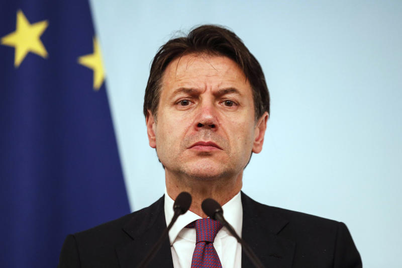 Italian Prime Minister Giuseppe Conte attends a press conference at the end of a Cabinet Minister meeting in Rome, Wednesday, Nov. 6, 2019. Worried about big job losses, Italy's government met Wednesday with Indian steel baron Lakshmi Mittal and other company executives to try and convince ArcelorMittal, the world's largest steelmaker, not to pull out of a deal to acquire the steel plant in southern Italy. (Giuseppe Lami/ANSA Via AP)