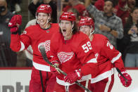 Detroit Red Wings left wing Tyler Bertuzzi (59) celebrate his goal against the Tampa Bay Lightning in the second period of an NHL hockey game Thursday, Oct. 14, 2021, in Detroit. (AP Photo/Paul Sancya)