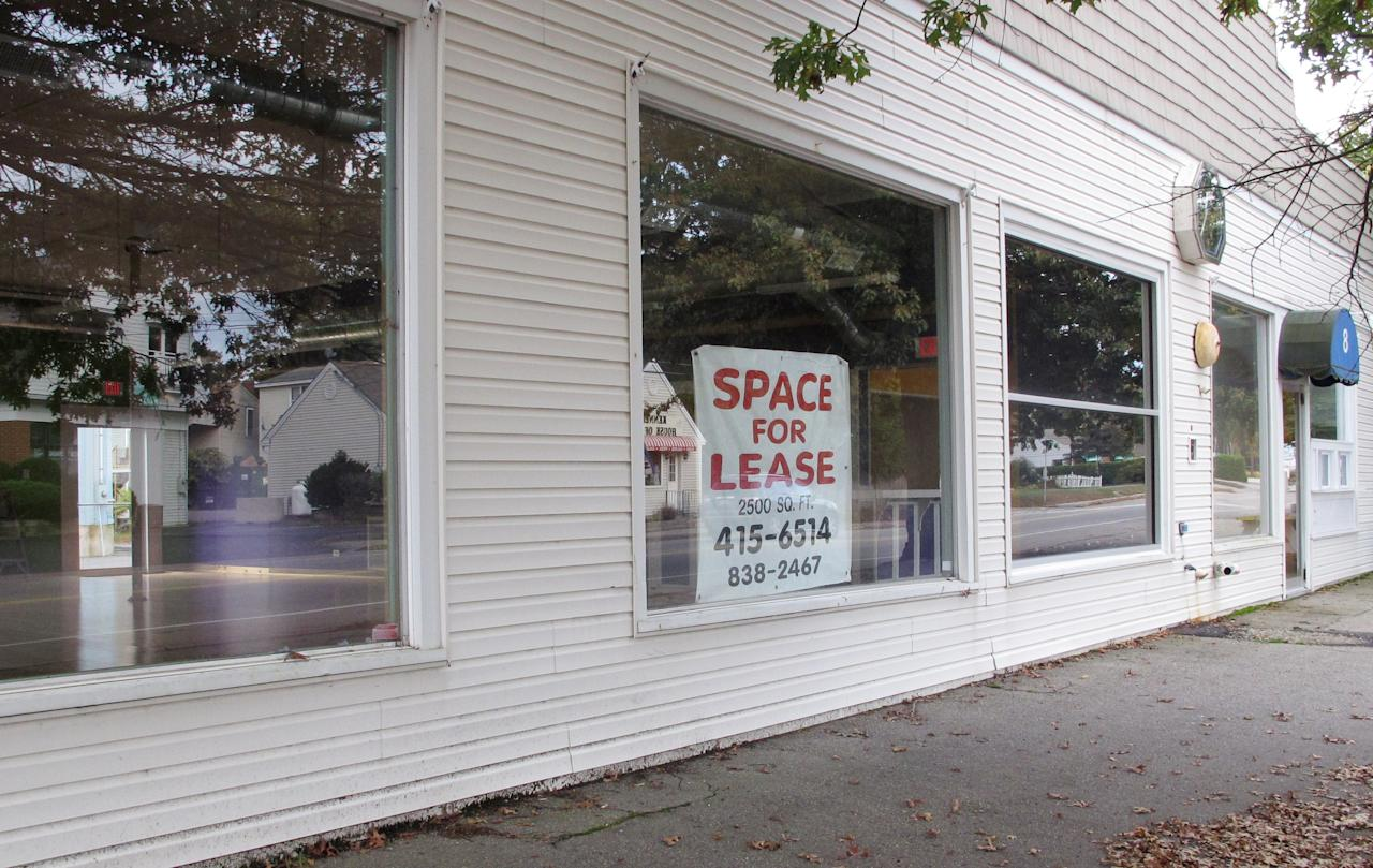 A for lease sign hangs on the window of the former Pura Vida fitness studio, in Kennebunk, Maine, Tuesday, Oct. 9, 2012. The woman who ran the business has been charged with running a prostitution operation out of the studio and a nearby one-room office. (AP Photo/Clarke Canfield)
