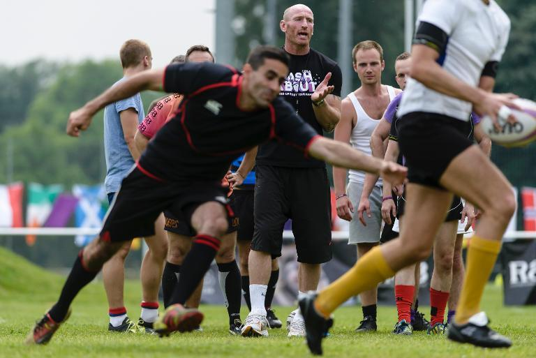 Welsh rugby player Gareth Thomas oversees a training session with members of the Berlin Bruisers on May 23, 2014 in Berlin