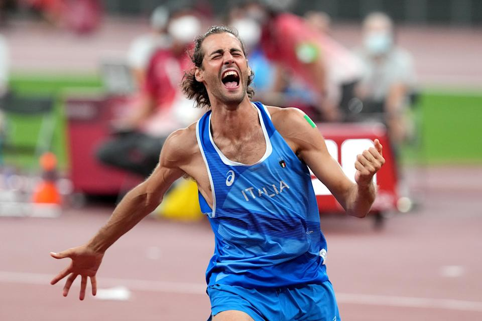 Italy's Gianmarco Tamberi celebrated his 'joint' gold medal in the high jump (Martin Rickett/PA) (PA Wire)