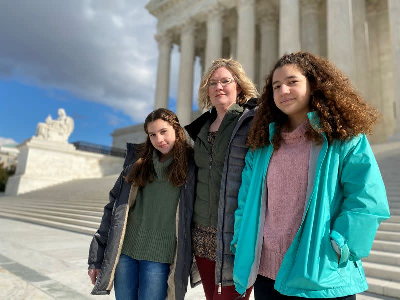 FILE PHOTO: Montana resident Kendra Espinoza, a key plaintiff in a major religious rights case to be argued before the U.S. Supreme Court, poses in front of the building in Washington