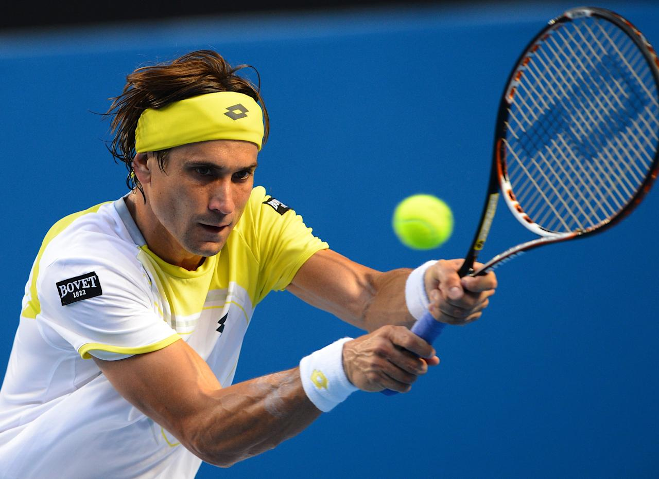 Spain's David Ferrer hits a return against Belgium's Olivier Rochus during their men's singles first round match on day one of the Australian Open tennis tournament in Melbourne on January 14, 2013.  AFP PHOTO / WILLIAM WEST IMAGE STRICTLY RESTRICTED TO EDITORIAL USE - STRICTLY NO COMMERCIAL USEWILLIAM WEST/AFP/Getty Images