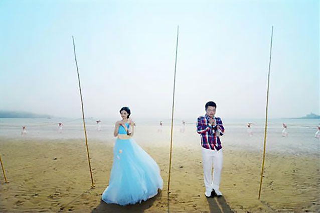 Xue and Ye on their wedding day. Source: AsiaWire