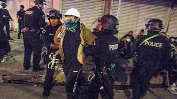 PHOTO: In this May 31, 2020, file photo, Los Angeles police officers arrest a demonstrator in Los Angeles.  (Ringo H.w. Chiu/AP, File)
