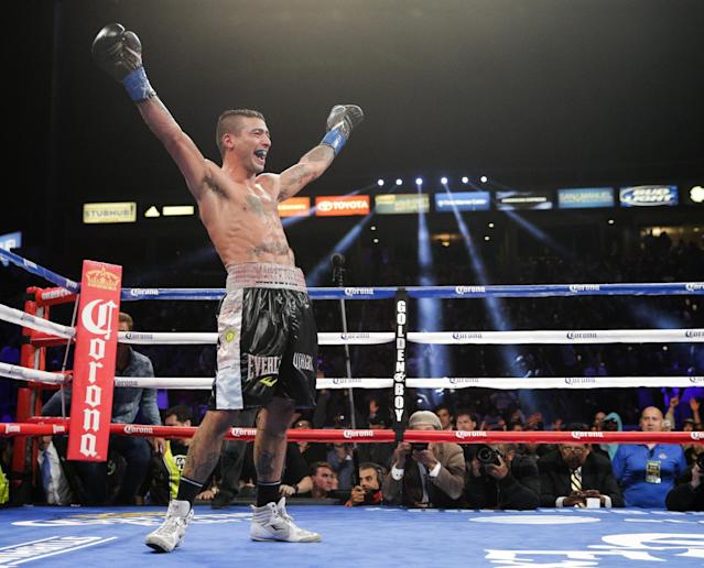 Lucas Matthysse, of Argentina, celebrates his 11th-round knockout victory against John Molina Jr. in a junior welterweight boxing match Saturday, April 26, 2014, in Carson, Calif. (AP Photo/Jae C. Hong)