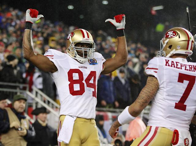 San Francisco 49ers wide receiver Randy Moss (84) celebrates his touchdown catch from quarterback Colin Kaepernick (7) in the first quarter of an NFL football game against the New England Patriots in Foxborough, Mass., Sunday, Dec. 16, 2012. (AP Photo/Steven Senne)