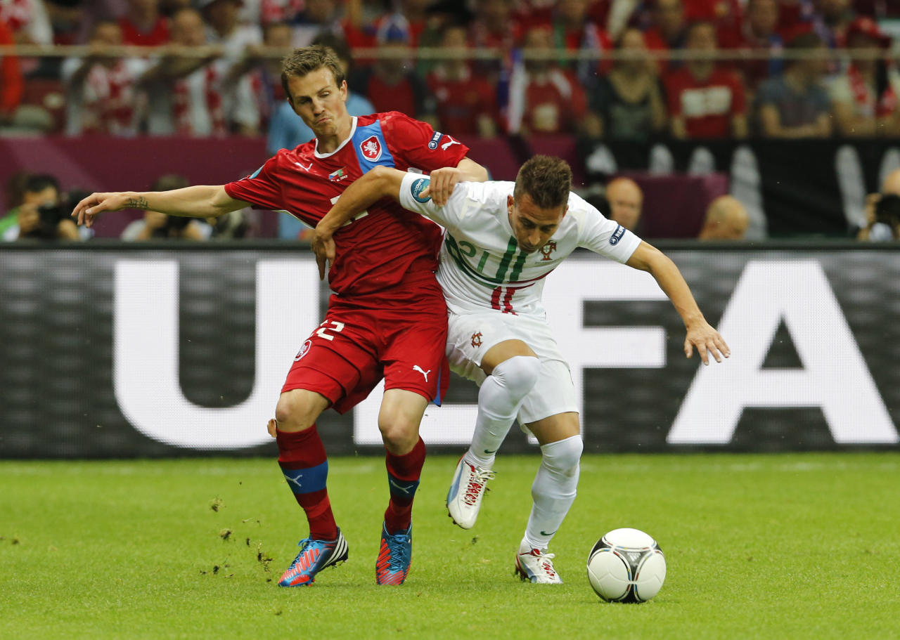Czech Republic's Vladimir Darida, left, and Portugal's Joao Pereira challenge for the ball during the Euro 2012 soccer championship quarterfinal match between Czech Republic and Portugal in Warsaw, Poland, Thursday, June 21, 2012. (AP Photo/Antonio Calanni)