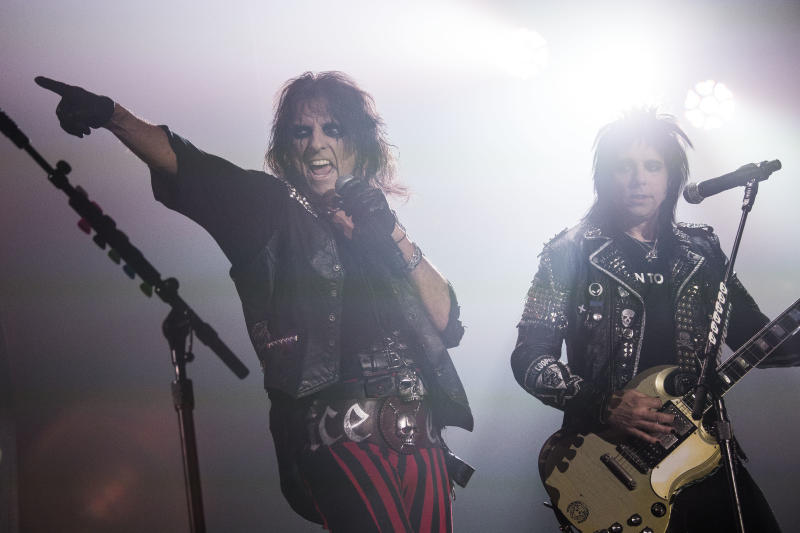 FILE - In this Nov. 6, 2015 file photo, Alice Cooper, left, performs at Wembley Arena in London. Many of the rock 'n' roll bands that were huge in 1977 will comprise a big part of the summer concert market 40 years later. Concert industry executives say nostalgia acts are still reliable sellers, with satellite and classic rock radio keeping their hits alive. (Photo by Joel Ryan/Invision/AP, File)