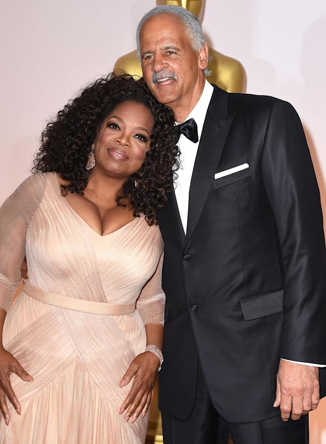Oprah Winfrey and Stedman Graham smile as they arrive at the Vanity Fair Oscar party in 2015, but that isn't good tabloid material. They look too happy! (Photo: Steve Granitz/WireImage)
