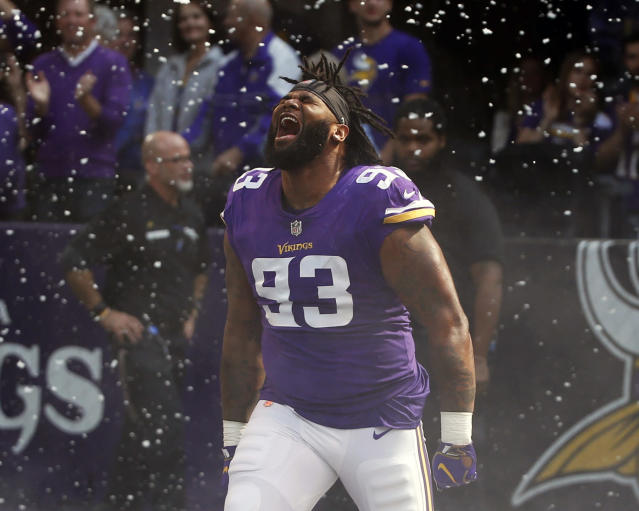FILE - In this Sept. 23,2018, file photo, Minnesota Vikings defensive tackle Sheldon Richardson runs onto the field before an NFL football game against the Buffalo Bills, in Minneapolis. Richardson is two teams past his time with the New York Jets, refusing to acknowledge any desire for revenge on his original employer that traded him away. He's having a solid first season with the Vikings. The Vikings play at the Jets on Sunday, Oct. 21. (AP Photo/Bruce Kluckhohn, File)
