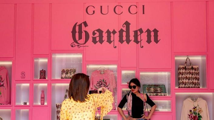 Two women tour the Gucci Aria Collection exhibition for the centennial celebration Shanghai, China.