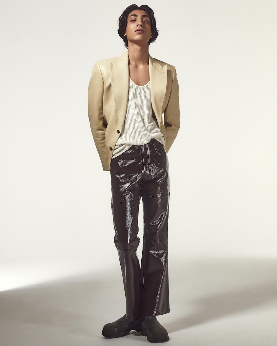 Blazer, $6,190, by Tom Ford. Pants, $1,695, by Ami Paris. Tank top, $250, by Amiri. Boots, $210, by Blundstone.