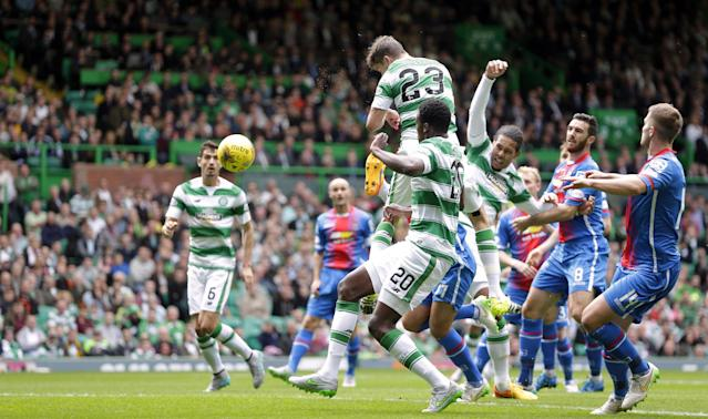 "Football - Celtic v Inverness Caledonian Thistle - Ladbrokes Scottish Premiership - Celtic Park - 15/8/15 Celtic's Mikael Lustig (top) scores their first goal Action Images via Reuters / Graham Stuart Livepic EDITORIAL USE ONLY. No use with unauthorized audio, video, data, fixture lists, club/league logos or ""live"" services. Online in-match use limited to 45 images, no video emulation. No use in betting, games or single club/league/player publications. Please contact your account representative for further details."