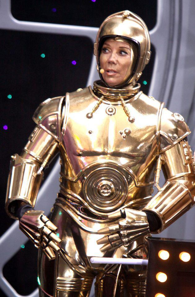 <p>In a surprise move, Gifford wore the clunky C-3PO costume. At least she had Hoda to help her with her wine glass! (Photo: INF Photo) </p>