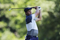 Bryson DeChambeau hits from the ninth tee during the second round of the Rocket Mortgage Classic golf tournament, Friday, July 3, 2020, at the Detroit Golf Club in Detroit. (AP Photo/Carlos Osorio)