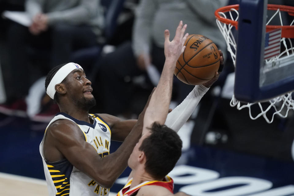Indiana Pacers' Caris LeVert shoots against Atlanta Hawks' Danilo Gallinari during the second half of an NBA basketball game Thursday, May 6, 2021, in Indianapolis. (AP Photo/Darron Cummings)