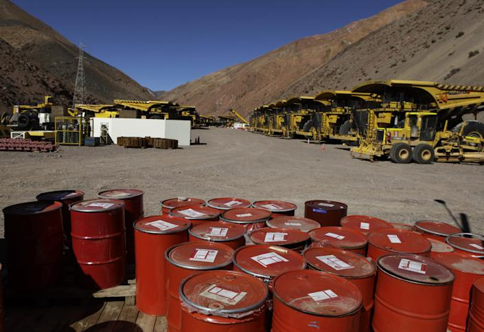 """Mining machinery and barrels with chemicals sit on the facilities of Barrick Gold Corp's Pascua-Lama project in northern Chile, Thursday, May 23, 2013. Chile's environmental regulator has stopped construction and imposed sanctions on Barrick Gold Corp.'s $8.5 billion Pascua-Lama project, citing """"serious violations"""" of its environmental permit. (AP Photo/Jorge Saenz)"""