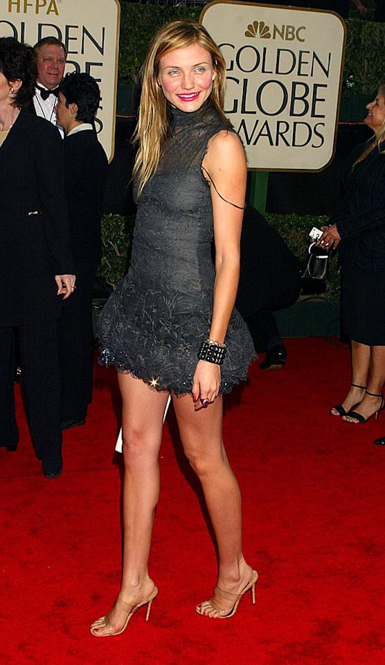 """Just because she was attending the Golden Globes didn't mean Cameron was about to show up in a floor-length ball gown like so many of her fellow starlets usually do. On the contrary, the actress went the opposite direction and strutted her stuff in this racy and lacy Chanel frock. """"I was going for my own look,"""" she said on the red carpet. Yes, she was! (1/19/2003)"""