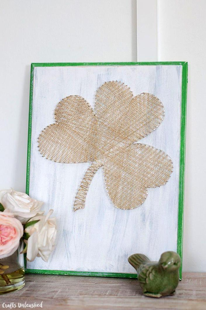 """<p>This blogger skipped the traditional green and made her shamrock gleam with gold lamé cord against a white chalk background. Can you say rustic glam? </p><p><strong>Get the tutorial at <a href=""""http://blog.consumercrafts.com/seasonal/spring/st-patricks-day-decorations/string-shamrock-art/"""" rel=""""nofollow noopener"""" target=""""_blank"""" data-ylk=""""slk:Crafts Unleashed"""" class=""""link rapid-noclick-resp"""">Crafts Unleashed</a>.</strong></p><p><a class=""""link rapid-noclick-resp"""" href=""""https://go.redirectingat.com?id=74968X1596630&url=https%3A%2F%2Fwww.walmart.com%2Fsearch%2F%3Fquery%3Dwhite%2Bchalk%2Bpaint&sref=https%3A%2F%2Fwww.thepioneerwoman.com%2Fhome-lifestyle%2Fcrafts-diy%2Fg34931626%2Fst-patricks-day-decorations%2F"""" rel=""""nofollow noopener"""" target=""""_blank"""" data-ylk=""""slk:SHOP WHITE CHALK PAINT"""">SHOP WHITE CHALK PAINT</a><br></p>"""