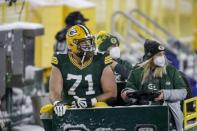 Green Bay Packers' Rick Wagner is taken off the field on a cart during the second half of an NFL football game against the Tennessee Titans Sunday, Dec. 27, 2020, in Green Bay, Wis. (AP Photo/Matt Ludtke)
