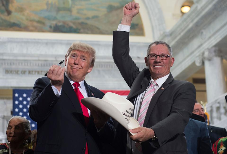 President Donald Trump holds up a pen after signing a proclamation shrinking Bears Ears and Grand Staircase-Escalante national monuments at the Utah State Capitol in Salt Lake City in December 2017. (Photo: SAUL LOEB via Getty Images)