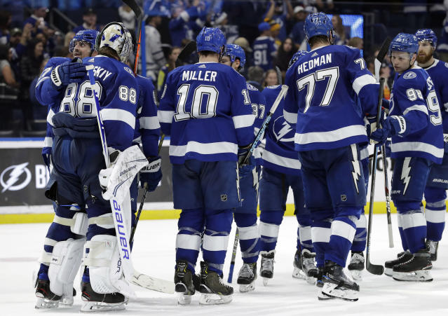 Tampa Bay Lightning goaltender Andrei Vasilevskiy (88) celebrates with teammates after the team defeated the Toronto Maple Leafs 4-1 during an NHL hockey game Thursday, Dec. 13, 2018, in Tampa, Fla. (AP Photo/Chris O'Meara)