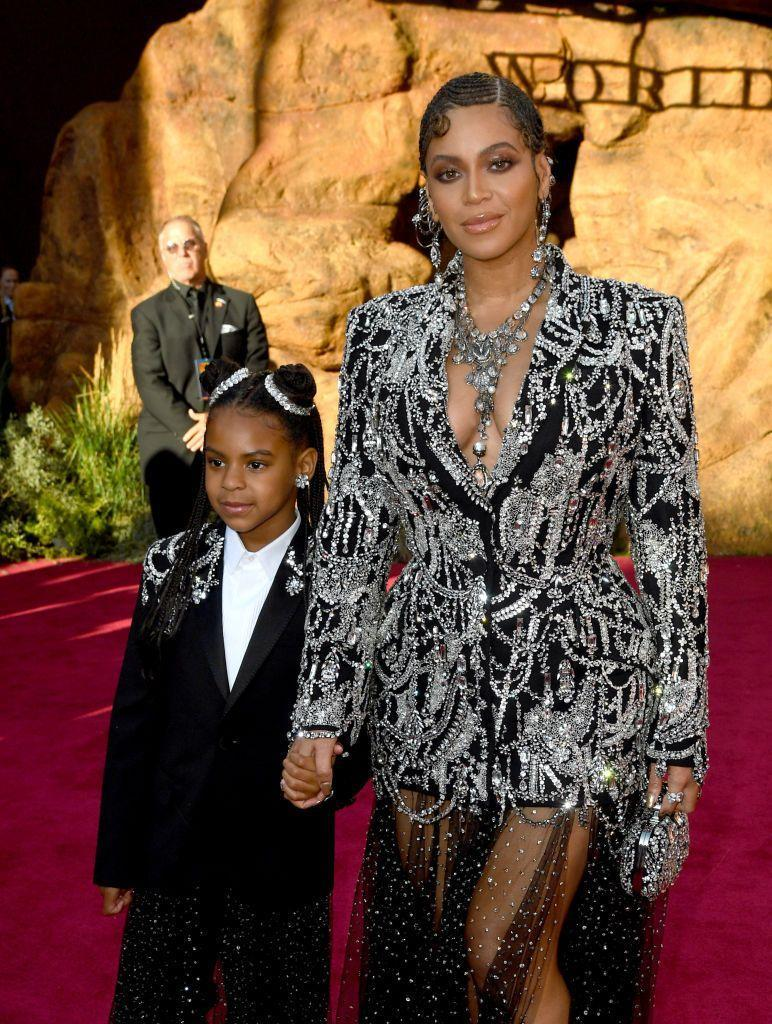 """<p><a href=""""https://www.elle.com/uk/life-and-culture/culture/a29608262/emilia-clarke-beyonce-meet/"""" rel=""""nofollow noopener"""" target=""""_blank"""" data-ylk=""""slk:Beyoncé"""" class=""""link rapid-noclick-resp"""">Beyoncé</a> and her eldest daughter, seven-year-old <a href=""""https://www.elle.com/uk/life-and-culture/a29063061/beyonce-documentary-lion-king-album-is-coming/"""" rel=""""nofollow noopener"""" target=""""_blank"""" data-ylk=""""slk:Blue Ivy"""" class=""""link rapid-noclick-resp"""">Blue Ivy</a>, look the spitting image of each other and are regularly seen in coordinated outfits on the red carpet.</p><p>In July, the singer wore an elaborate custom-made Alexander McQueen look to the Los Angeles premiere of her film The Lion King, which features an embellished deep-cut blazer and a crystal-covered sheer skirt. Meanwhile, her daughter wore a matching embellished blazer and sheer skirt.</p>"""
