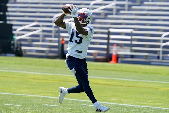 New England Patriots wide receiver N'Keal Harry (15) makes a catch during an NFL football practice in Foxborough, Mass., Thursday, May 27, 2021. (AP Photo/Steven Senne)