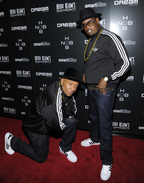 "FILE - In this Oct. 31, 2011 file photo, music producers Russell Simmons, left, and Andre Harrell pose for photos at Heidi Klum's annual Halloween party in New York. Harrell, the Uptown Records founder who shaped the sound of hip-hop and R&B in the late '80s and '90s with acts like Mary J. Blige and Heavy D and also launched the career of mogul Sean ""Diddy"" Combs, has died, several members of the music community revealed late Friday, May 8, 2020. He was 59. (AP Photo/Evan Agostini)"