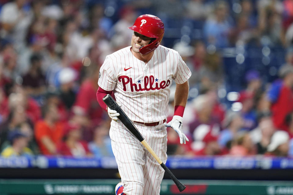 Philadelphia Phillies' Rhys Hoskins reacts after flying out against Tampa Bay Rays pitcher Ryan Yarbrough during the third inning of an interleague baseball game, Wednesday, Aug. 25, 2021, in Philadelphia. (AP Photo/Matt Slocum)