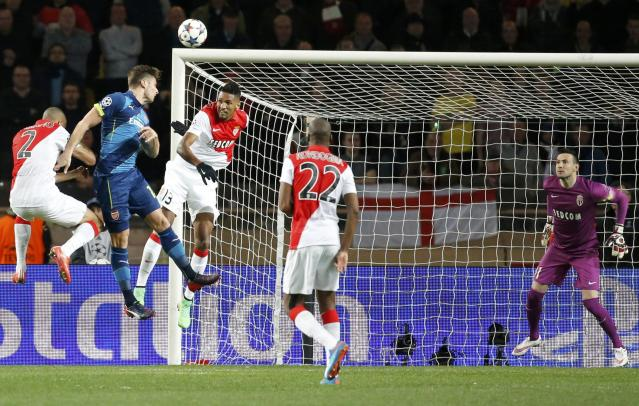 Arsenal's Olivier Giroud (2ndL) jumps high as he heads the ball against AS Monaco's (L-2ndR) Fabinho, Wallace, Geoffrey Kondogbia during their Champions League round of 16 second leg soccer match at the Louis II Stadium in Monaco, March 17, 2015. REUTERS/Eric Gaillard (MONACO - Tags: SPORT SOCCER)