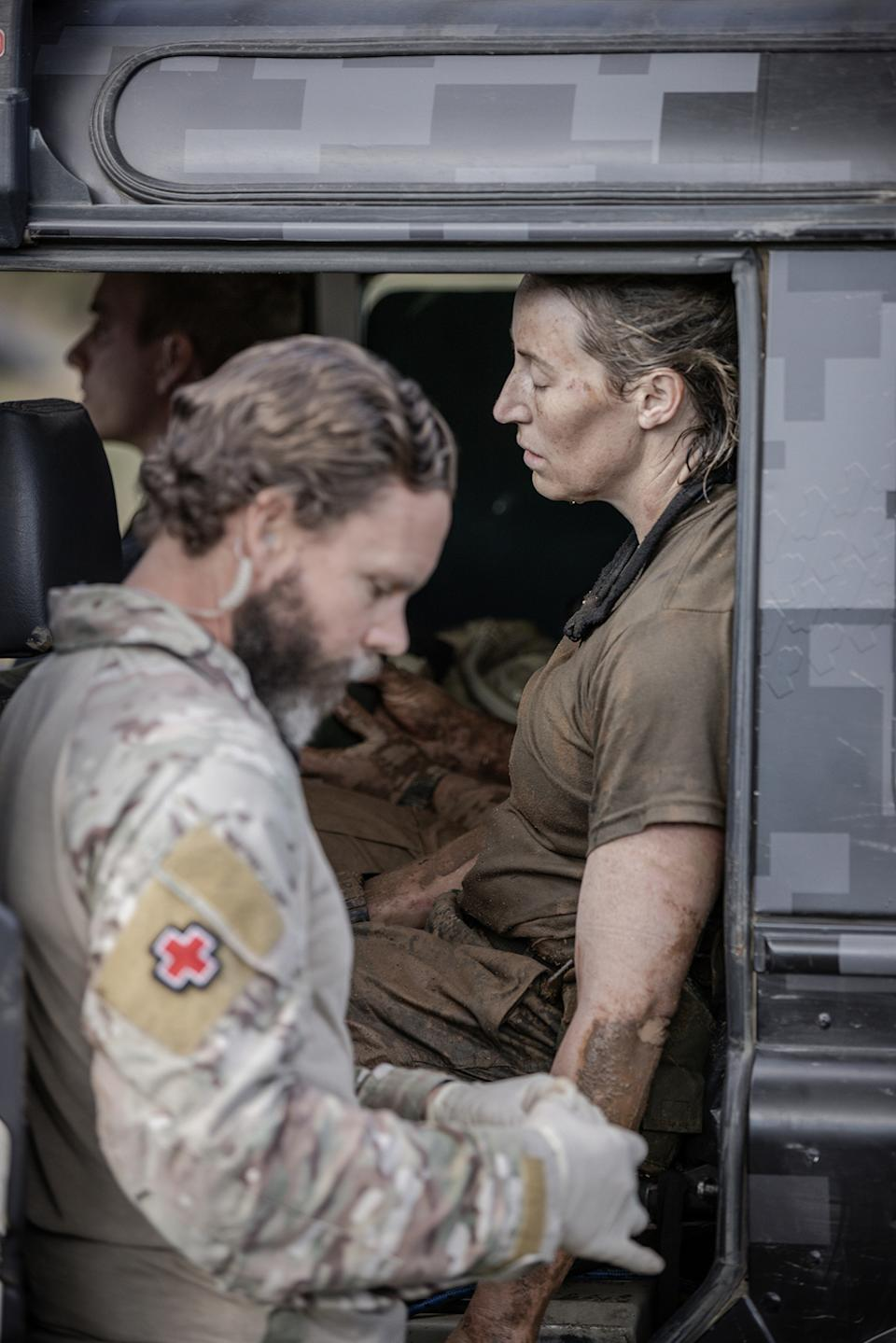 SAS Australia star Jana Pittman receives medical attention after collapsing in episode 12. Photo: Channel 7.