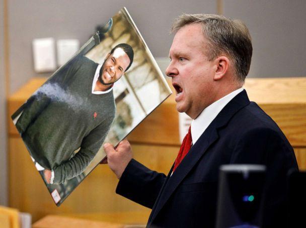 PHOTO: Assistant District Attorney Jason Hermus waves a photo of Botham Jean at the jury as he presents his closing arguments in Amber Guyger's murder trial in Dallas, Texas, Sept. 30, 2019.  (Tom Fox/The Dallas Morning News via AP, Pool)