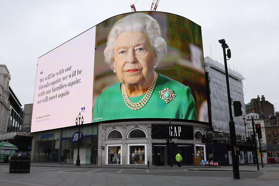 LONDON, April 13, 2020  -- A screen shows British Queen Elizabeth II and a quote from her speech on the fight against COVID-19 at Piccadilly Circus in London, Britain, April 13, 2020. The death toll of those hospitalized in Britain who tested positive for the novel coronavirus reached 10,612 as of Saturday afternoon, the Department of Health and Social Care said Sunday. (Photo by Tim Ireland/Xinhua via Getty) (Xinhua/ via Getty Images)