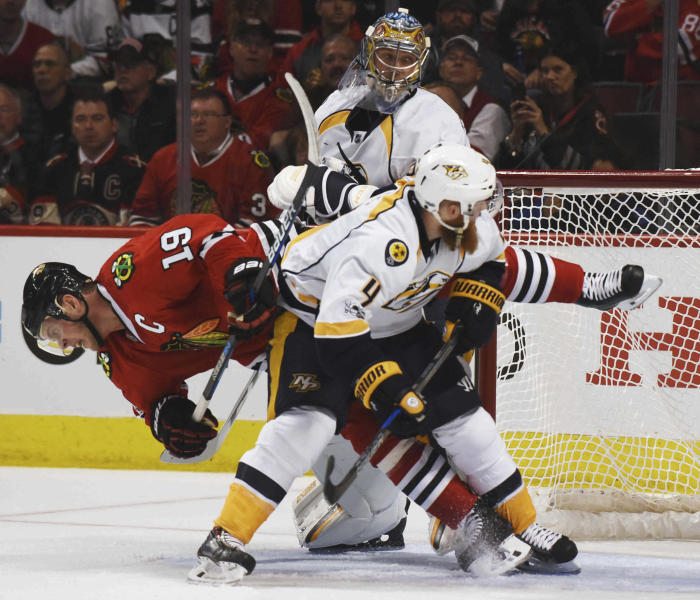 Chicago Blackhawks center Jonathan Toews falls to the ice after coming into contact with Nashville Predators defenseman Ryan Ellis during Game 1 of a first-round NHL hockey playoff series Thursday, April 13, 2017, in Chicago. (Joe Lewnard/Daily Herald via AP)