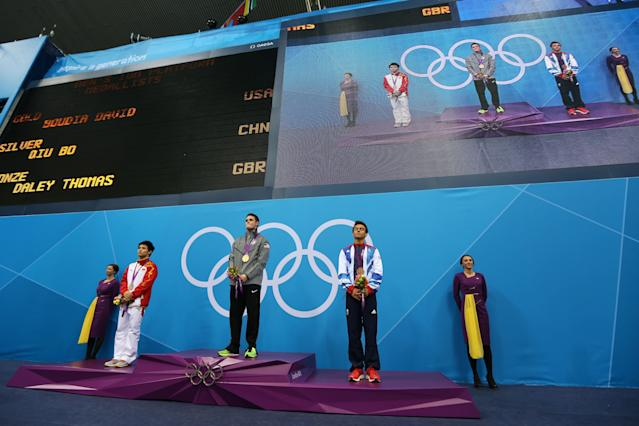 LONDON, ENGLAND - AUGUST 11: Silver medallist Bo Qui of China, gold medallist David Boudia of the United States, and bronze medallist Tom Daley of Great Britain pose on the podium during the medal ceremony for the Men's 10m Platform Diving Final on Day 15 of the London 2012 Olympic Games at the Aquatics Centre on August 11, 2012 in London, England. (Photo by Clive Rose/Getty Images)