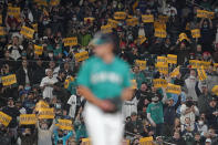"""Fans hold up signs that read """"Believe"""" as Seattle Mariners starting pitcher Marco Gonzales throws against the Los Angeles Angels during the first inning of a baseball game, Friday, Oct. 1, 2021, in Seattle. Fans and the team have adopted the one-word slogan that was recently featured on the TV series """"Ted Lasso"""" as the Mariners battle for a spot in the MLB playoffs. (AP Photo/Ted S. Warren)"""