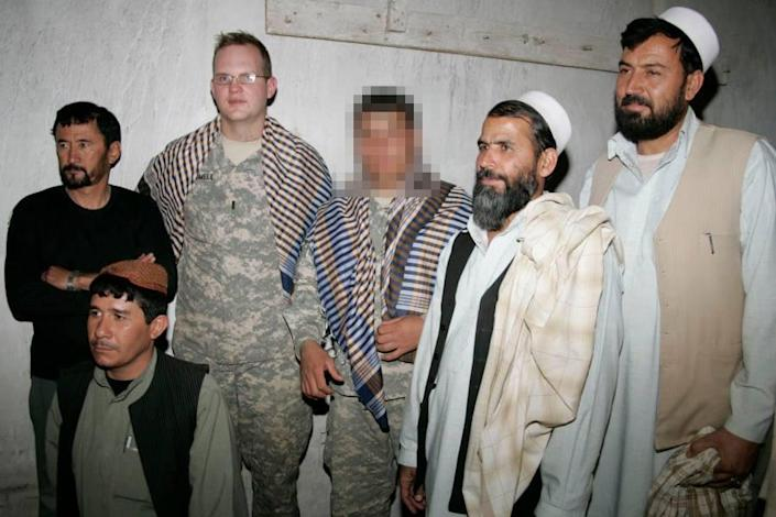 IMAGE: An Afghan interpreter stands next to former Army Capt. Jeff Trammell (Courtesy Najeeb Rahimi)