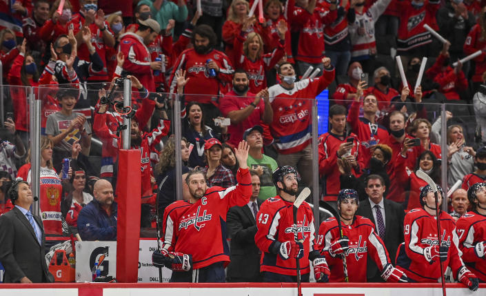 WASHINGTON , DC - OCTOBER 13: Washington Capitals left wing Alex Ovechkin (8) waves to the crowd after he scored and advanced to number 5 on the all-time NHL scoring list during action against the New York Rangers at Capital One Arena. (Photo by Jonathan Newton/The Washington Post via Getty Images)