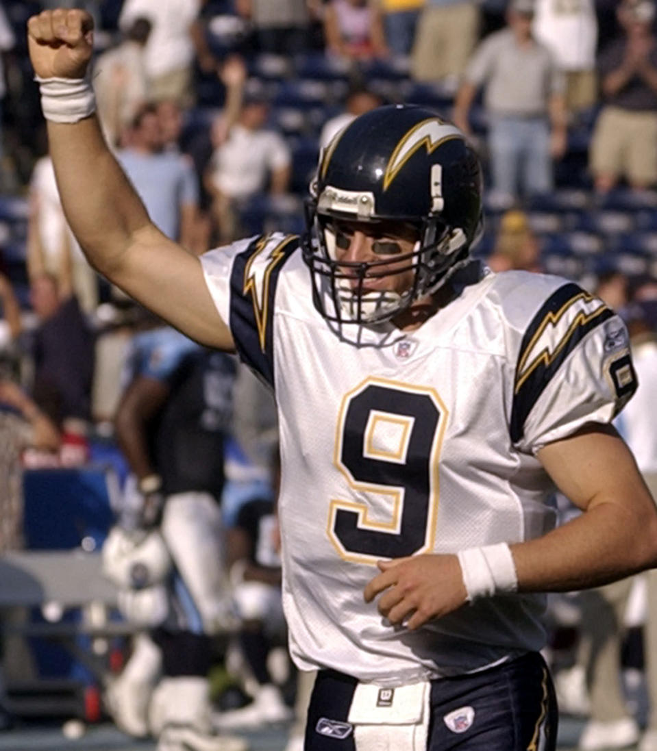 File-This Oct. 3, 2004, file photo shows San Diego Chargers quarterback Drew Brees pumping his fist as the Chargers score another touchdown in the fourth quarter of their 38-17 victory over the Tennessee Titans in San Diego. Brees, the NFL's leader in career completions and yards passing, has decided to retire after 20 NFL seasons, including his last 15 with New Orleans. (AP Photo/Denis Poroy, File)