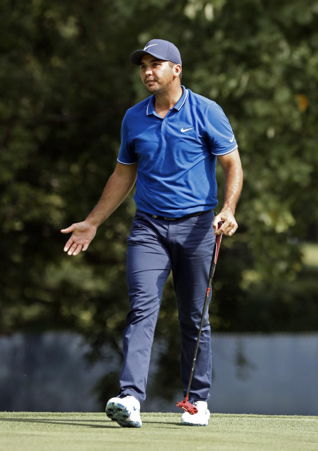 Jason Day, of Australia, reacts to his missed putt on the 17th hole during the first round of the PGA Championship golf tournament at Bellerive Country Club, Thursday, Aug. 9, 2018, in St. Louis. (AP Photo/Brynn Anderson)