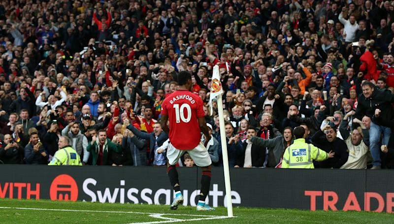 MANCHESTER, ENGLAND - OCTOBER 20: Marcus Rashford of Manchester United celebrates scoring their first goal during the Premier League match between Manchester United and Liverpool FC at Old Trafford on October 20, 2019 in Manchester, United Kingdom. (Photo by John Peters/Manchester United via Getty Images)