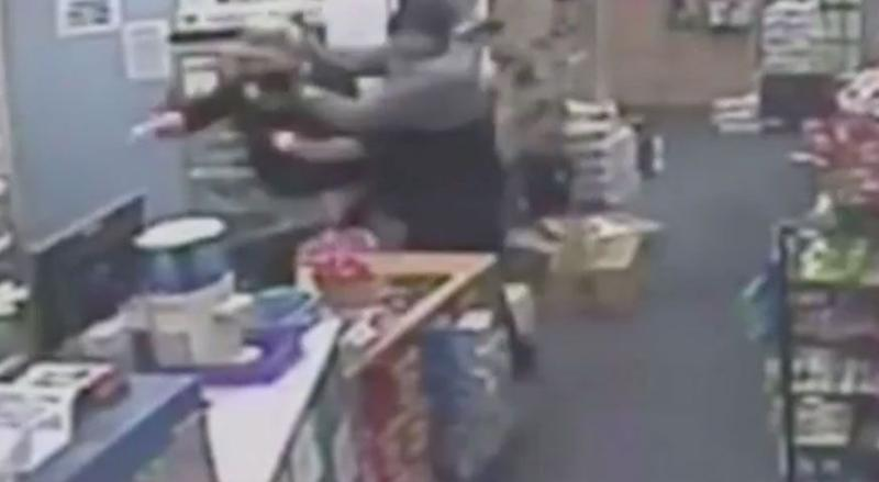 The man then rushes towards the woman, holding a screwdriver to her neck. Source: 7 News