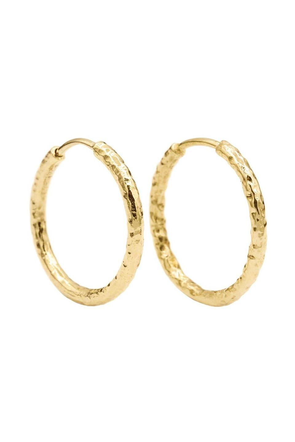 """<p><strong>Octavia Elizabeth</strong></p><p>octaviaelizabeth.com</p><p><strong>$675.00</strong></p><p><a href=""""https://www.octaviaelizabeth.com/collections/earrings/products/gabby-hoop"""" rel=""""nofollow noopener"""" target=""""_blank"""" data-ylk=""""slk:Shop Now"""" class=""""link rapid-noclick-resp"""">Shop Now</a></p><p>Upgrade your everyday yellow gold hoops with Octavia Elizabeth's beautiful hammered gold earrings. Available in multiple sizes plus with and without various gems will have you wearing them everyday.</p>"""