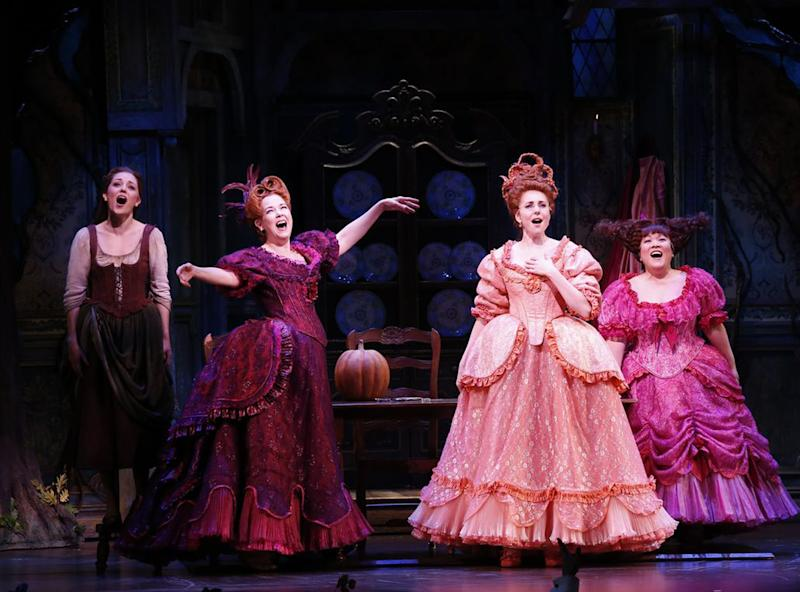 """This theater image released by Sam Rudy Media Relations shows, from left, Laura Osnes as Cinderella, Harriet Harris as Cinderella's stepmother; Marla Mindelle as stepsister Gabrielle and Ann Harada as stepsister Charlotte. during a performance of """"Rodgers + Hammerstein's Cinderella on Broadway."""" (AP Photo/Sam Rudy Media Relations, Carol Rosegg)"""