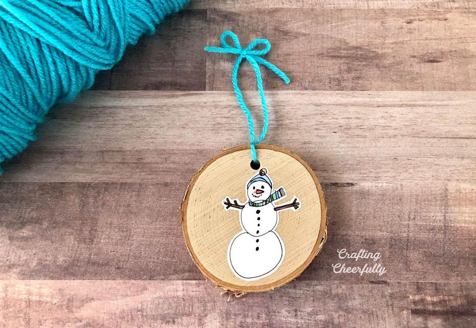 """<p>This DIY is a joint effort between you and the kids. Have them draw a seasonal picture that you can transfer onto wooden slices. It makes a great Christmas gift for grandparents. </p><p><em>Get the tutorial at <a href=""""https://www.craftingcheerfully.com/diy-childrens-art-keepsake-ornament/"""" rel=""""nofollow noopener"""" target=""""_blank"""" data-ylk=""""slk:Crafting Cheerfully"""" class=""""link rapid-noclick-resp"""">Crafting Cheerfully</a>. </em></p><p><a class=""""link rapid-noclick-resp"""" href=""""https://www.amazon.com/CEWOR-24pcs-Natural-Slices-Holes/dp/B07G13BL5P?tag=syn-yahoo-20&ascsubtag=%5Bartid%7C10072.g.34443405%5Bsrc%7Cyahoo-us"""" rel=""""nofollow noopener"""" target=""""_blank"""" data-ylk=""""slk:SHOP WOOD SLICE ORNAMENTS"""">SHOP WOOD SLICE ORNAMENTS</a></p>"""