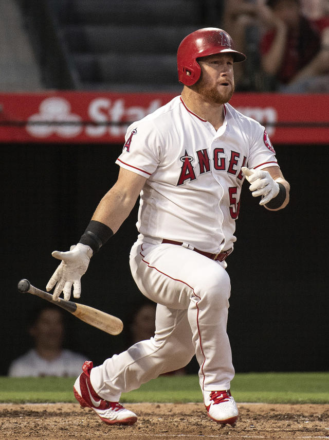 Los Angeles Angels' Kole Calhoun hits an RBI-double during the third inning of a baseball game against the Chicago White Sox in Anaheim, Calif., Monday, July 23, 2018. (AP Photo/Kyusung Gong)