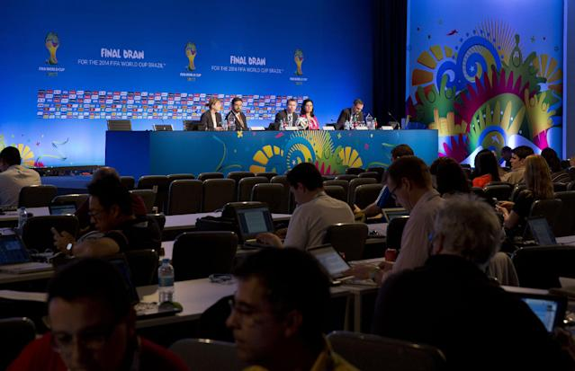 Members of the organizing committee hold a press conference ahead of the World Cup draw at the beach resort of Costa do Sauipe, Brazil, Wednesday, Dec. 4, 2013. The draw for the 2014 World Cup finals takes place Friday. (AP Photo/Andre Penner)